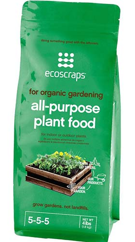 A close up of the packaging of Ecoscraps Organic All-Purpose Plant Food on a white background.