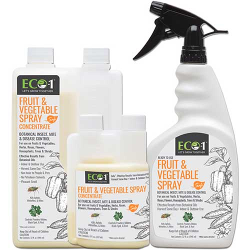 A close up of the packaging of Eco-1 Fruit and Vegetable Spray on a white background.