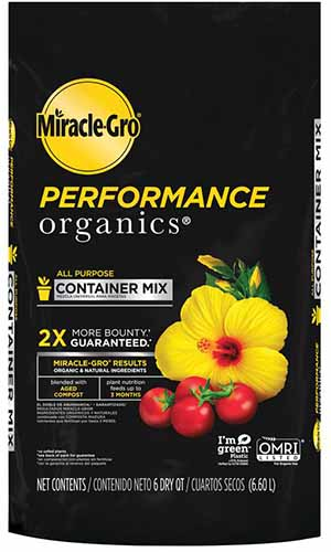 A close up of the black packaging with yellow text of Miracle-Gro Performance Organics potting soil on a white background.