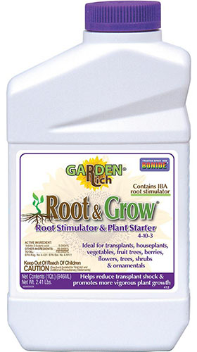 A close up of the packaging of Root and Grow, a plant fertilizer, pictured on a white background.