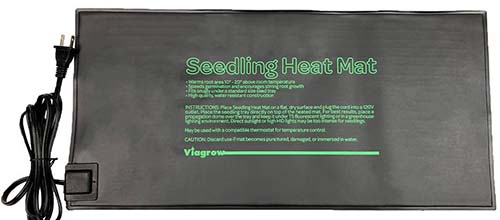 A close up of a small black plastic seedling heat mat by Viagrow on a white background.