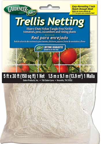 A close up square image of the packaging of trellis netting for supporting plants growing in the garden on a white background.