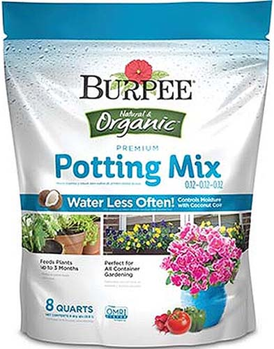 A close up vertical image of the packaging for Burpee's organic potting soil on a white background.