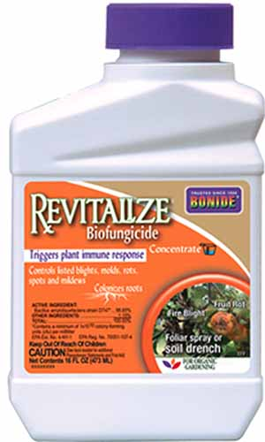 A close up vertical image of the packaging for Revitalize Biofungicide on a white background.