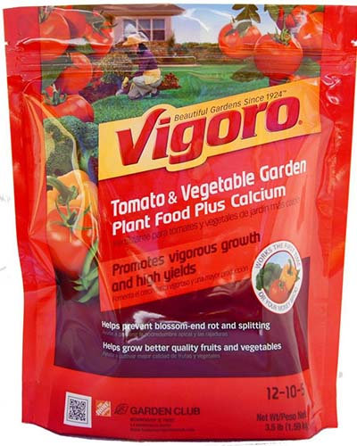 A close up square image of the packaging of Vigoro Tomato and Vegetable Garden Plant food.