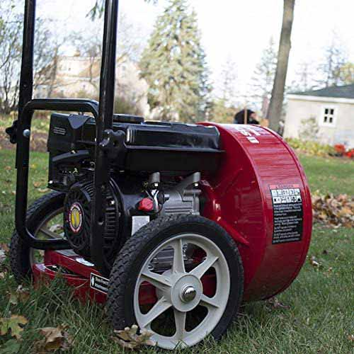 A close up square image of the Southland walk-behind leaf blower set on a lawn.
