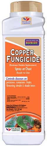 A close up vertical image of a bottle of Bonide Copper Fungicide Powder on a white background.
