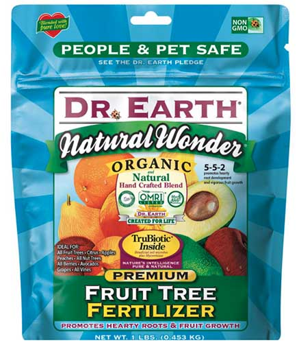 A close up square image of the packaging of Dr Earth Premium Fruit tree fertilizer pictured on a white background.