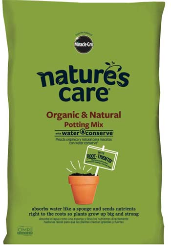 A close up square image of the packaging of Nature's Care Natural Potting mix.