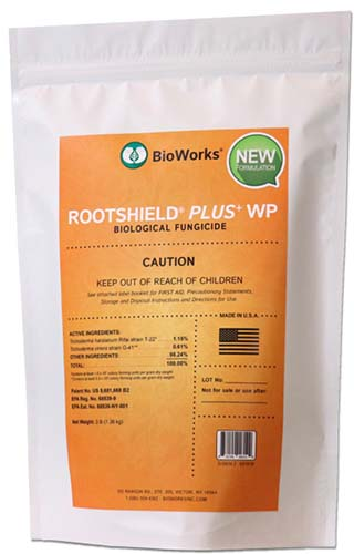 A close up vertical image of the packaging of BioWorks Rootshield plus biological fungicide pictured on a white background.