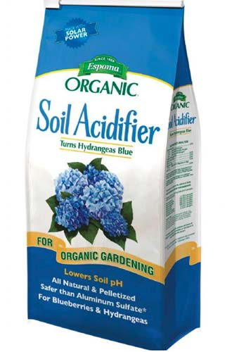 A close up vertical image of the packaging of Espoma Organic Soil Acidifier on a white background.