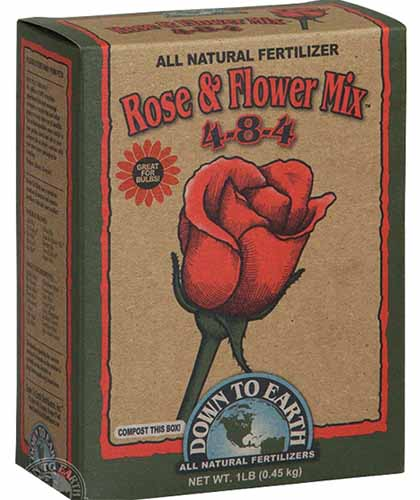 A close up of the cardboard packaging of Down to Earth Rose and Flower Mix pictured on a white background.