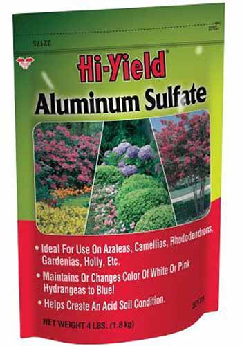 A close up vertical image of the packaging of Hi Yield Aluminum Sulfate pictured on a white background.