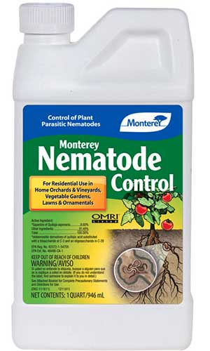 A close up vertical image of a plastic bottle of Monterey organic pest control product pictured on a white background.