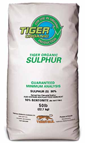A close up vertical image of the packaging of Tiger Organic Sulphur pictured on a white background.