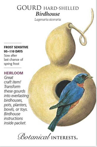 A close up vertical image of a seed packet with a gourd and a bird with writing to the top and left of the frame.