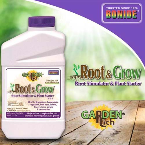 A close up square image of the packaging of Bonide Root and Grow rooting stimulator pictured on a wooden surface, with printed text to the top and right of the frame.