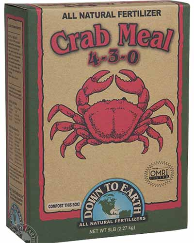 A close up square image of a box of Down to Earth's Crab Meal pictured on a white background.