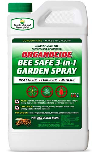A close up vertical image of the packaging of Organocide Bee Safe Garden Spray isolated on a white background.
