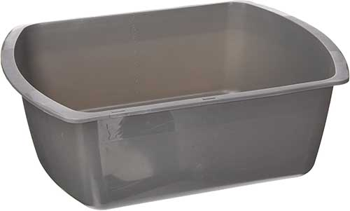 A close up horizontal image of a gray plastic container isolated on a white background.