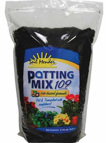 A close up square image of a package of Soil Mender Potting Mix 109 isolated on a white background.