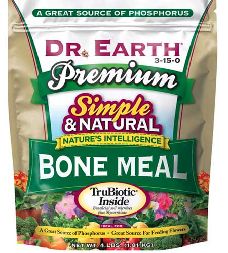 A close up vertical image of the packaging of Dr Earth's Simple and Natural Bone Meal isolated on a white background.
