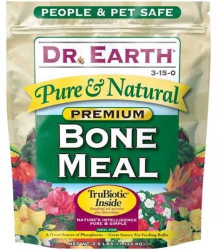 A close up square image of the packaging of Dr Earth Premium Bone Meal isolated on a white background.