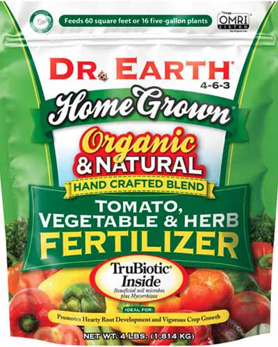 A close up square image of the packaging of Dr Earth Tomato, Vegetable, and Herb Fertilizer isolated on a white background.