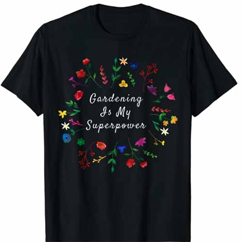 A close up square image of a black t-shirt with the slogan Gardening Is My Superpower printed on the front.