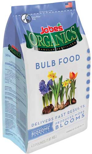 A close up vertical image of the packaging of Jobe's Organic Bulb Food isolated on a white background.