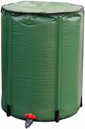 A close up vertical image of a portable rain barrel constructed from green PVC isolated on a white background.