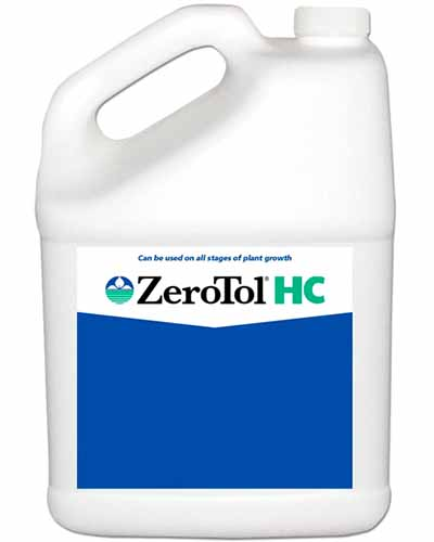A close up vertical image of a plastic bottle of ZeroTol HC isolated on a white background.