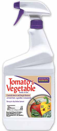 A close up vertical image of a spray bottle of Bonide Tomato and Vegetable Fertilizer isolated on a white background.