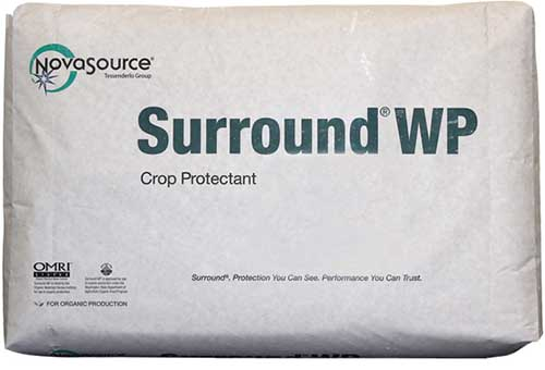 A close up horizontal image of the packaging of Surround WP Crop Protectant isolated on a white background.