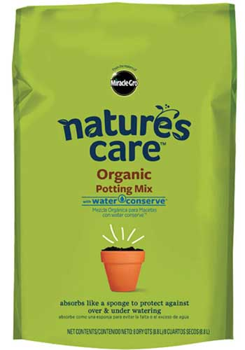 A close up vertical image of the packaging of Miracle-Gro Natures Care Organic Potting Mix isolated on a white background.