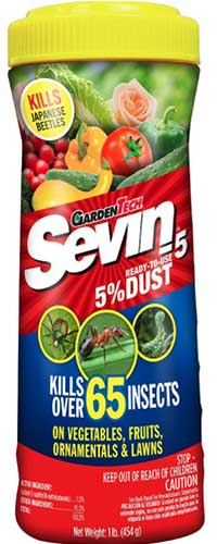 A close up vertical image of the packaging of Garden Tech Sevin Ready to Use Dust isolated on a white background.
