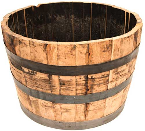 A close up square image of a wooden barrel for growing plants isolated on a white background.