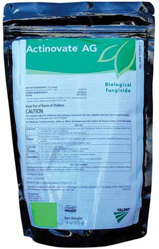 A close up vertical image of the packaging of Actinovate AG isolated on a white background.