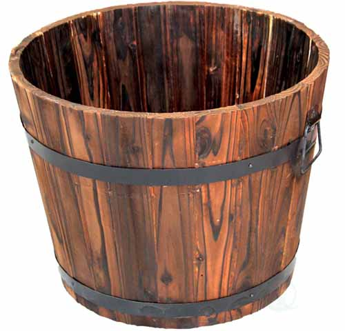 A close up square image of a wooden planter isolated on a white background.