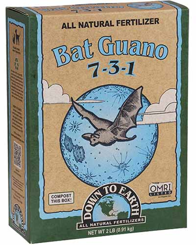 A close up square image of the packaging for Down to Earth Bat Guano isolated on a white background.
