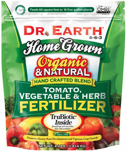 A close up square image of a bag of Dr Earth Tomato, Vegetable, and Herb Fertilizer isolated on a white background.