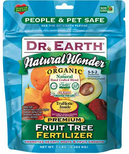 A close up square image of the packaging of Dr Earth Natural Wonder Organic Fruit Tree Fertilizer isolated on a white background.