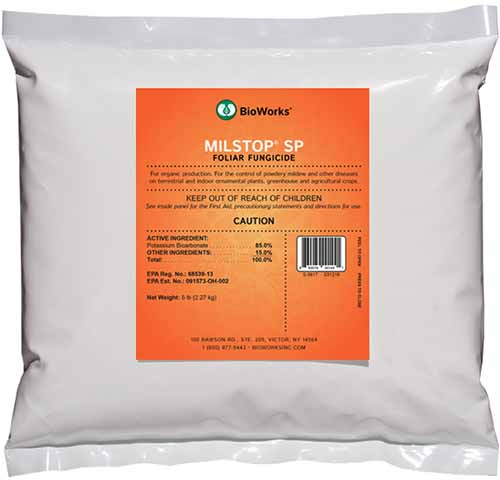A close up square image of a bag of MilSTop SP Foliar Fungicide isolated on a white background.