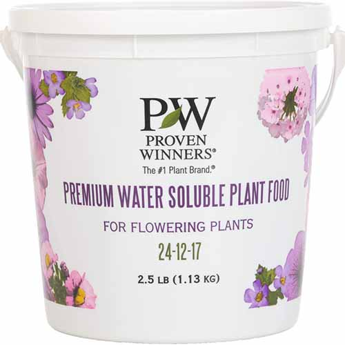 A close up square image of a tub of Proven Winners Premium Water Soluble Fertilizer isolated on a white background.