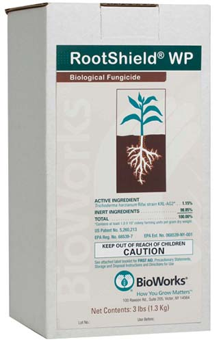 A close up vertical image of a box packaging of RootShield WP biological fungicide isolated on a white background.