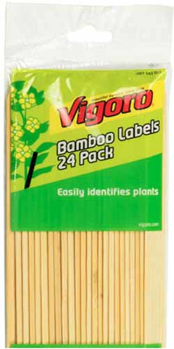 A close up vertical image of a packet of Vigoro Bamboo Labels isolated on a white background.