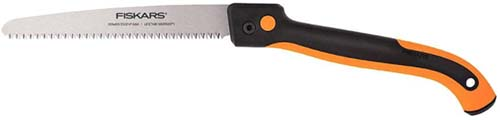 A close up horizontal image of a Fiskar's pruning saw isolated on a white background.
